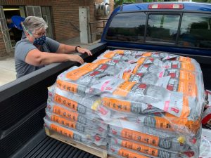 Volunteer delivering dog food